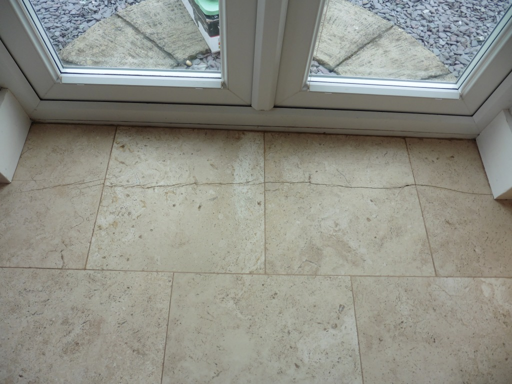 Cracked Travertine Tiles Before Repair in Worfield
