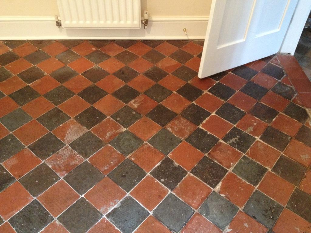 Black and Red Quarry Tiled Dining Room Before Cleaning in Shrewsbury